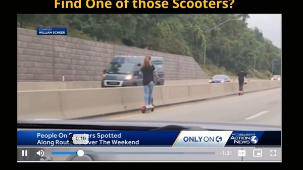 2 scooter riders on Route 28